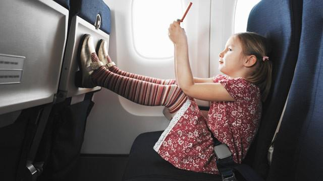 Little girl on an airplane